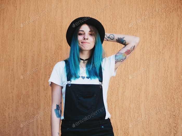 Portrait of Young hipster girl with blue hair