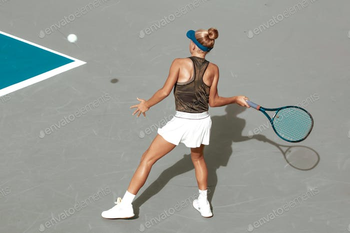 female tennis player, competitive sport, action shot, tennis court, shadow