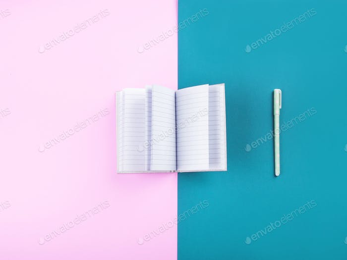 Open agenda with white pages on duotone pink and turquoise background