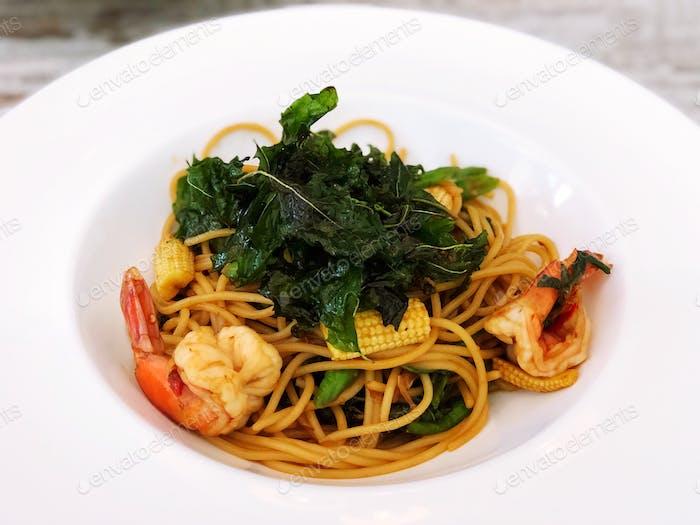 Thai-style spicy spaghetti with crispy fried basil