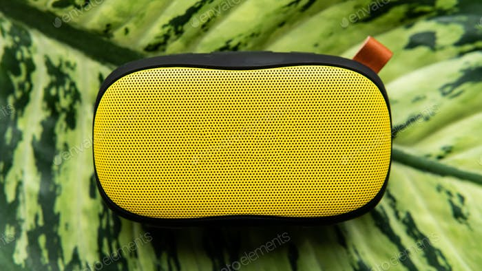 Portable yellow wireless sound on the natural background