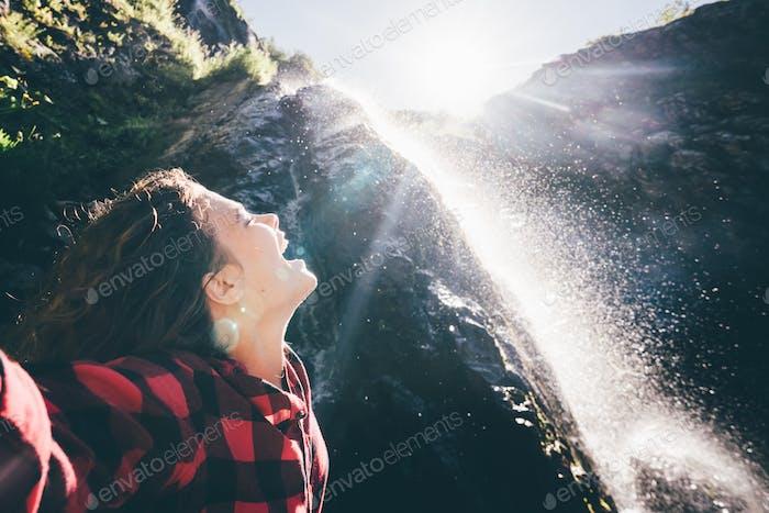 joy; arm; woman; waterfall; girl; nature; tourist; water; travel; raised; carefree; freedom; eco;