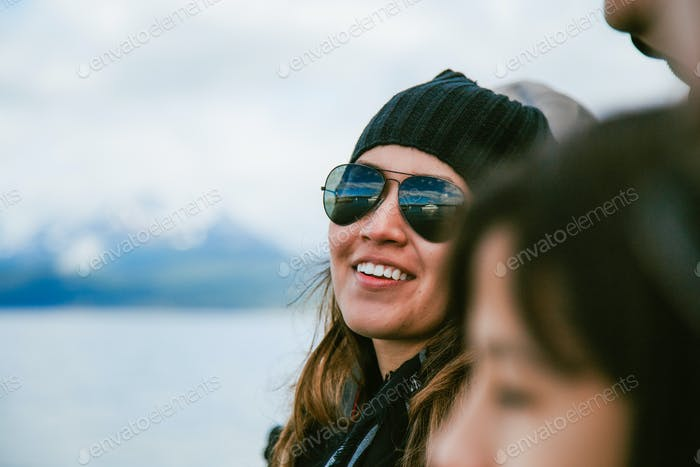 Woman out In public wearing glasses looking at the camera