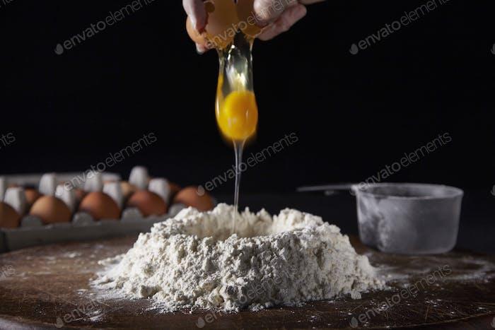 Cracking the egg to make fresh pasta dough!