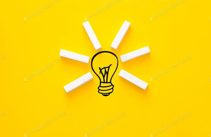 Lightbulb and wooden blocks with innovation basic links. Business ideas inspiration and innovation.