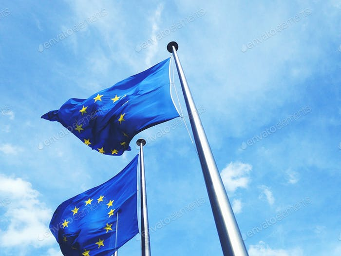 European union flag flying against blue sky
