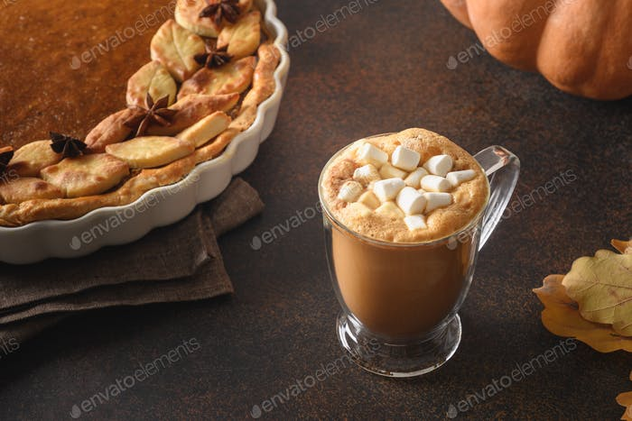 Warming coffee and homemade pumpkin pie with for autumn cozy day. Close up.