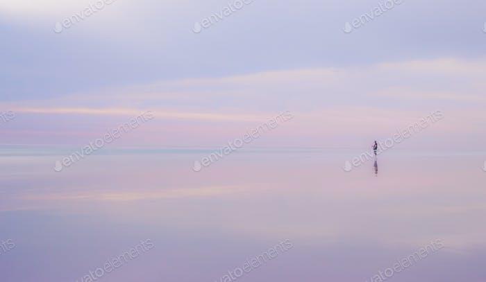 Lone fisherman on Broome Beach, Western Australia