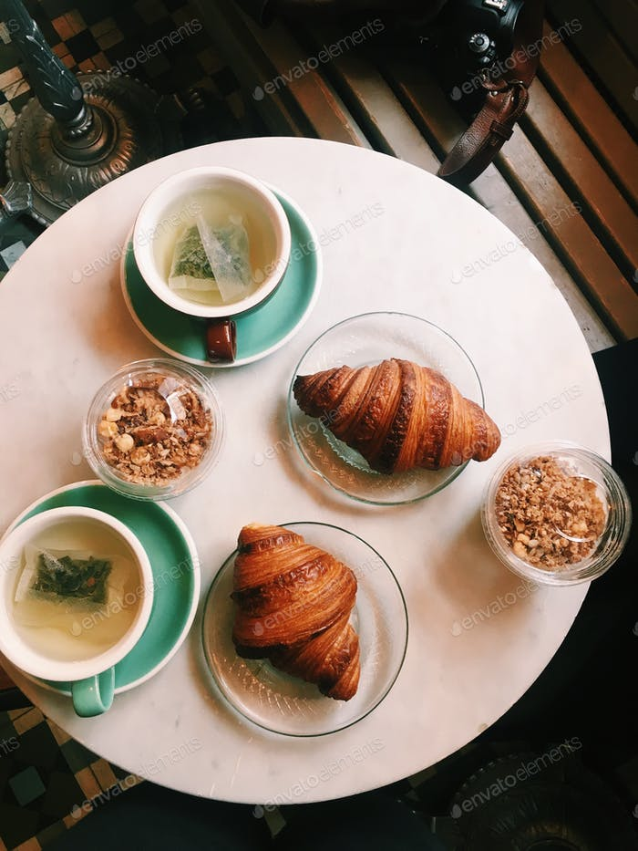 Breakfast: two cups of green tea, yoghurt with granola and two croissants