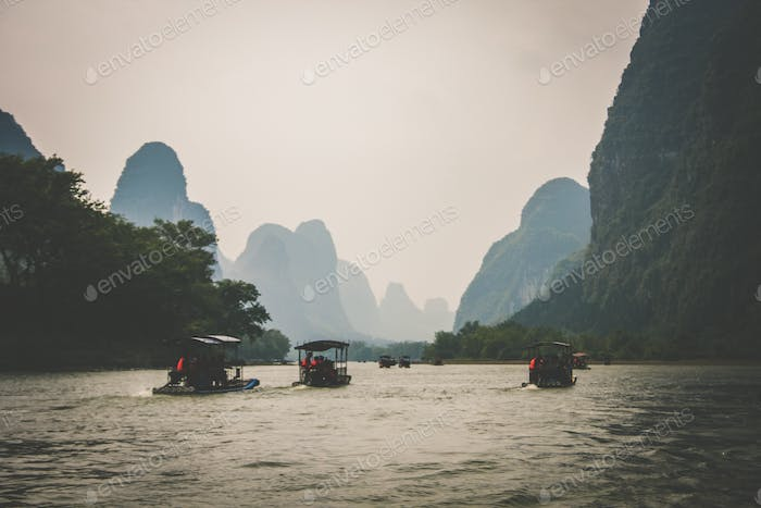 Sailing in a river in Yangshuo. Adventure. Wanderlust. Mountains. Travel. Mountain scenery.
