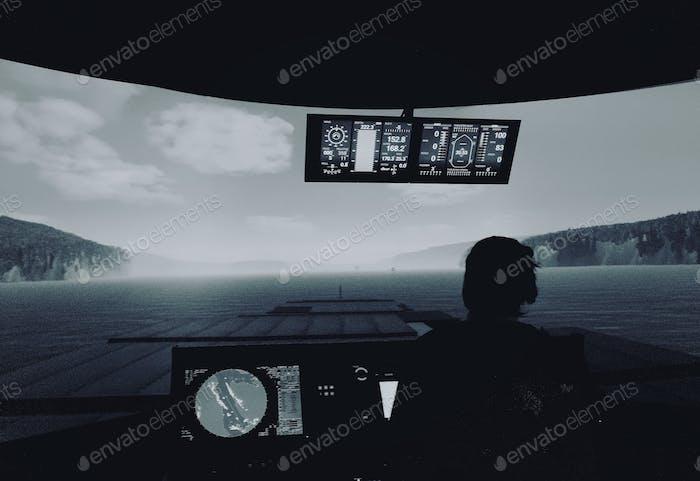 Future navigation officer in the maritime vessel's bridge simulator.