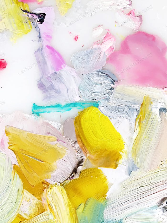 Bright cheerful paint smears blended on an artist's colorful palette.