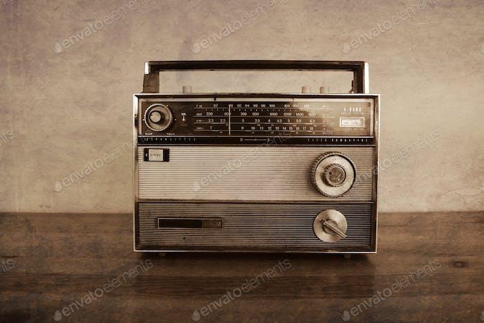 Transistor radio. Vintage, 1960's on a wood table