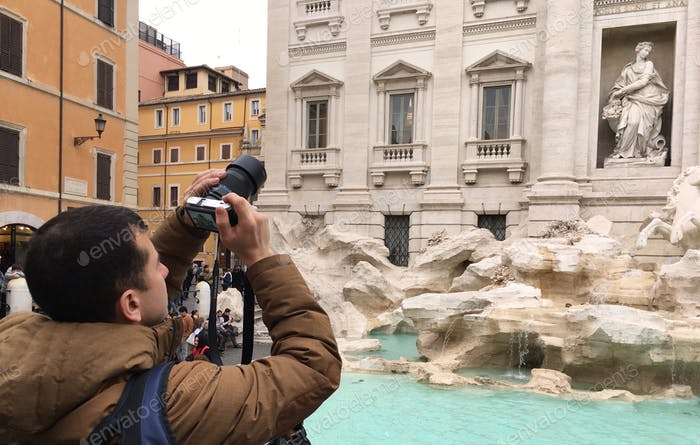 Tourist taking photos with professional camera In Rome Italy