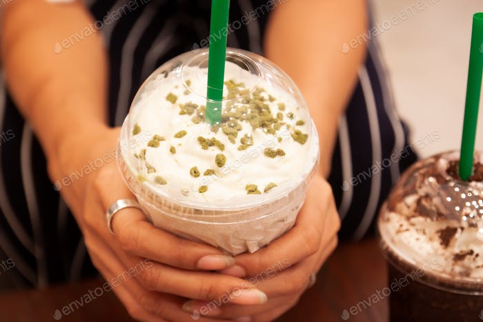 Starbucks Tea Ramisu Frappe with whipping cream in woman's hands