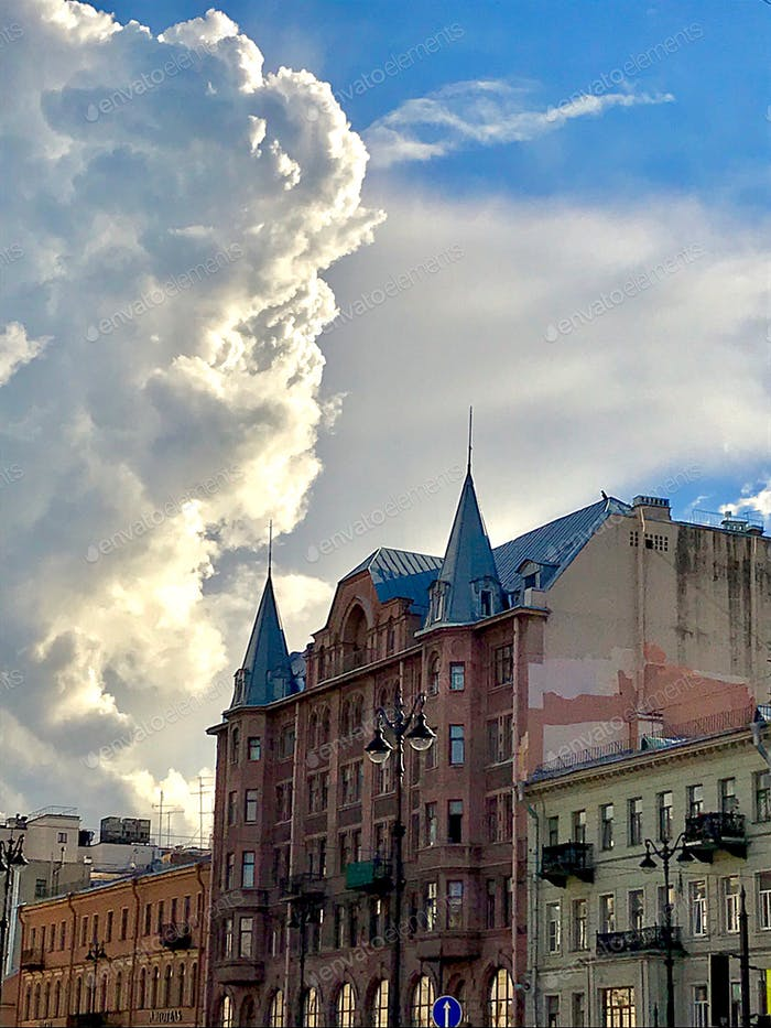 A beautiful old building and a large volumetric cloud