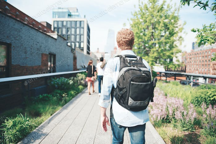 Guy walking outdoors on the highline