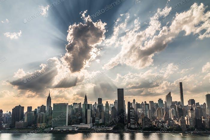 A giant burst of light rays over Manhattan skyline this evening.