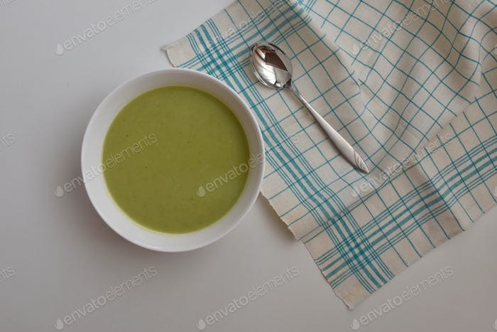 Broccoli soup on white table - directly above