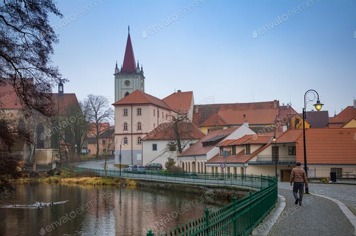 Man on embankment in small Czech town
