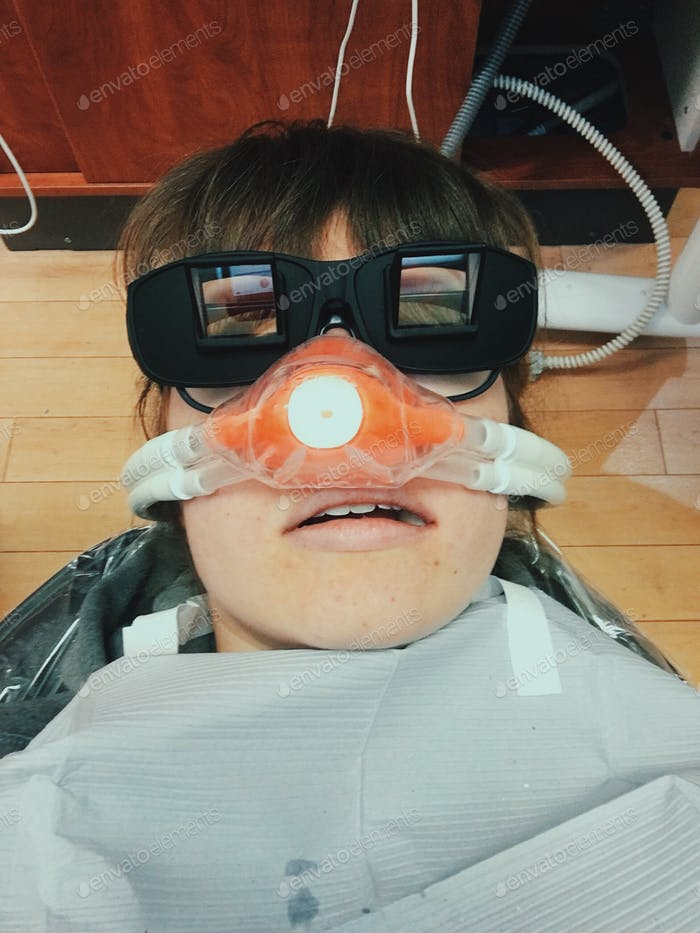 Young woman in a dentist's chair.