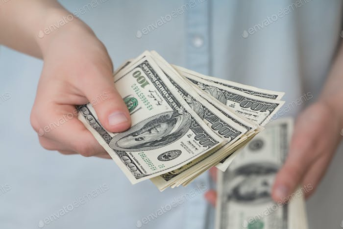 A girl with money in her hands