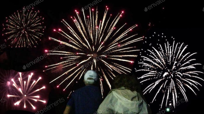 Grandparents watching a brilliant fireworks display