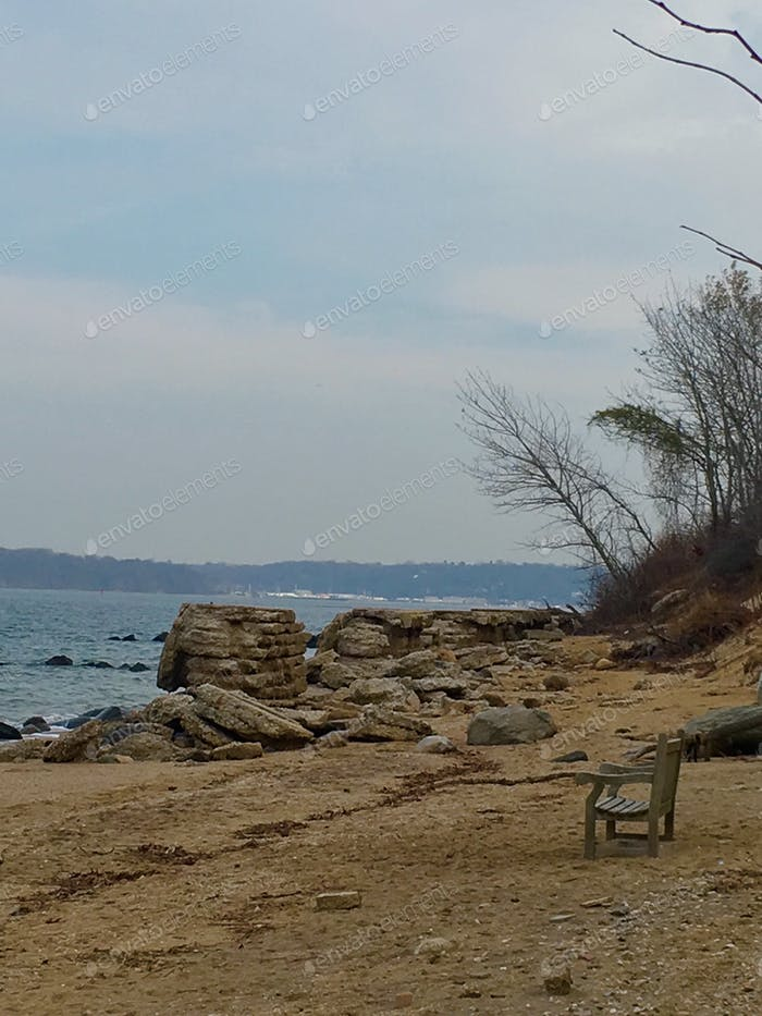Lonely bench on seashore