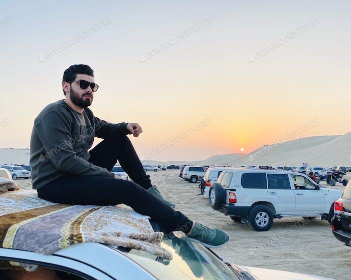 Sunset,sky,car,one person,sunglasses,Desert life, car