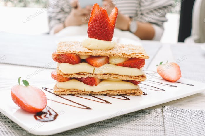 Mille-feuille, layered dessert with crepe and strawberry
