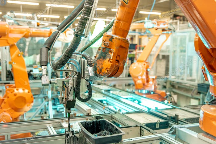 robot arms in the factory performs precise work according to the specified program