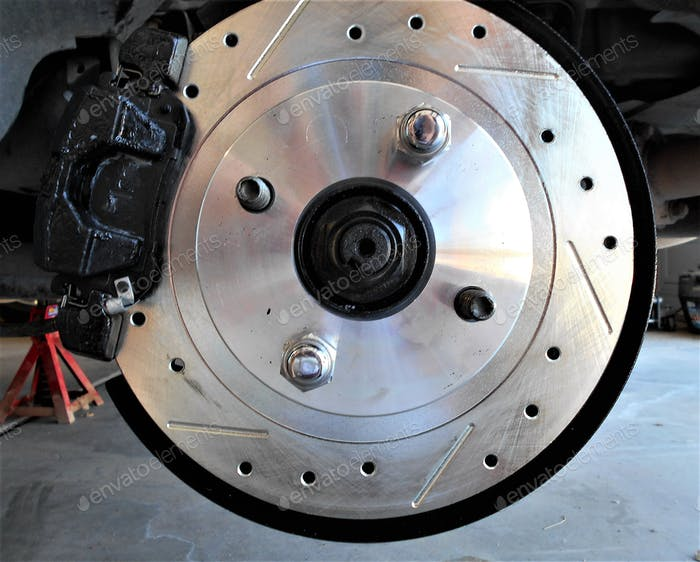 Newly Installed Brakes and Brake Drums on a Sports Car