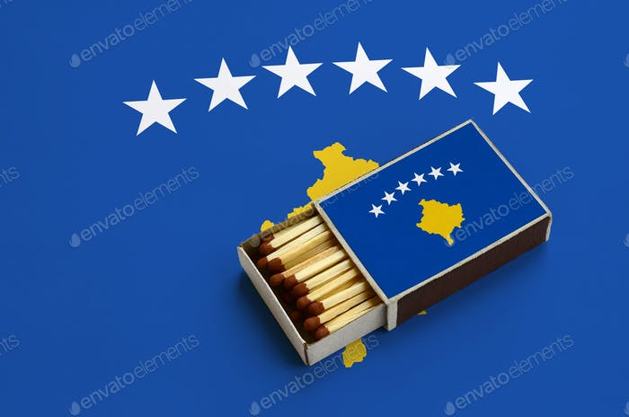 Kosovo flag  is shown in an open matchbox, which is filled with matches and lies on a large flag.