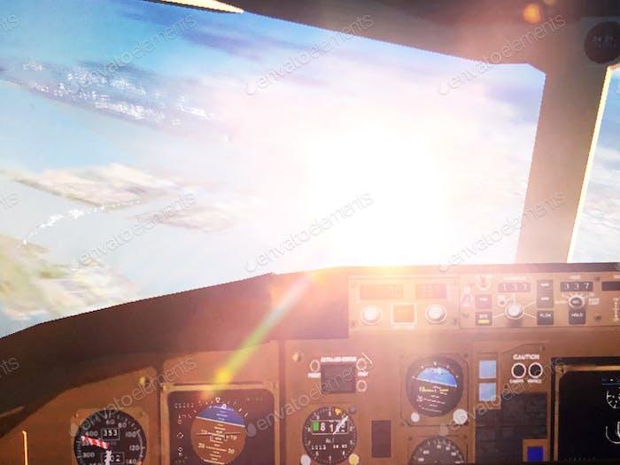Cockpit view in airplane simulator game arcade