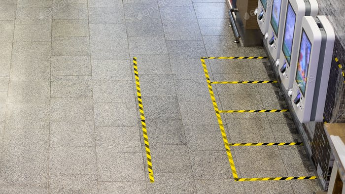 Secure marking of yellow lines on floor - measures for social distancing near self-service checkout