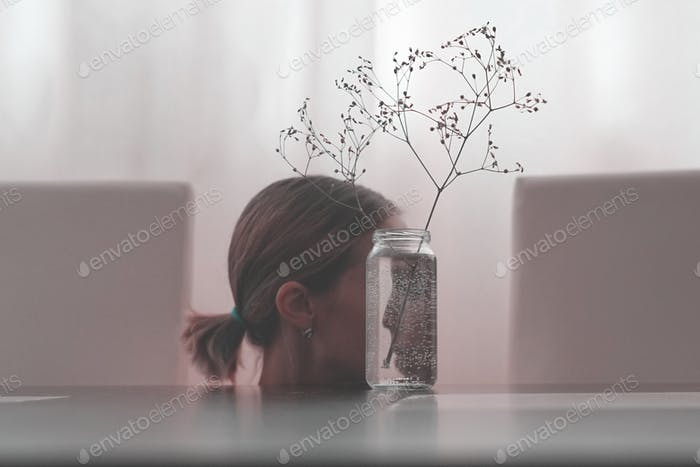 The girl's face reflected in a glass jar. Look into yourself. The psychological concept.