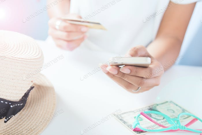 Woman's hands holding mobile phone and credit card. Online shopping