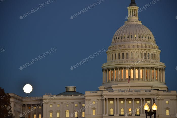 The us capital building at night with a full moon
