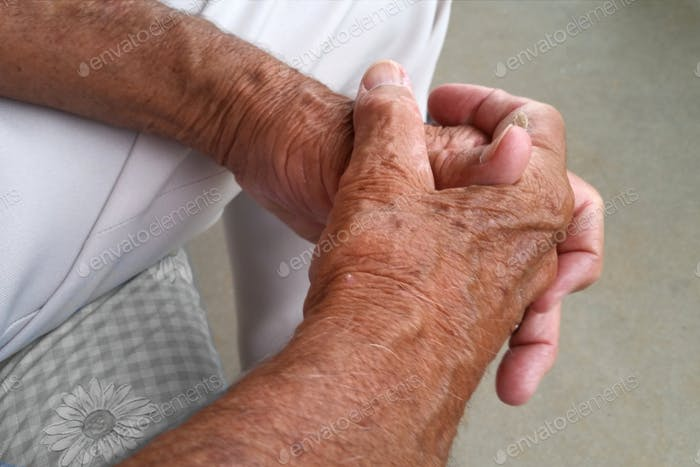 The clasped hands of an older man, elderly, senior citizen, father, grandfather,