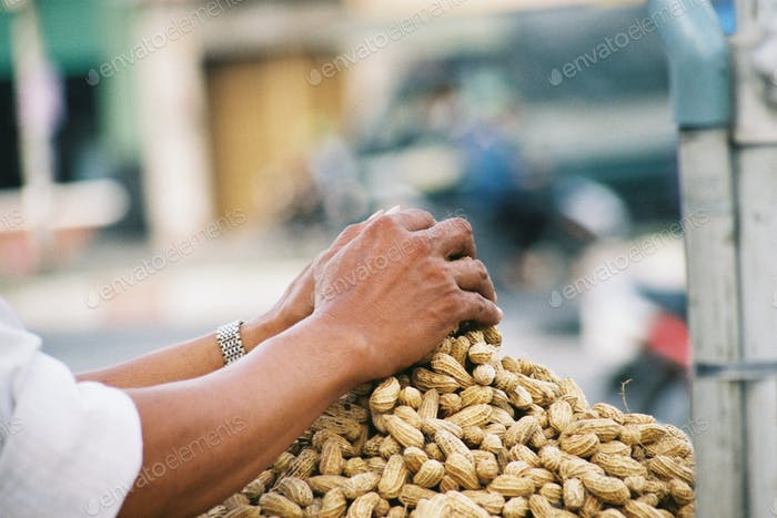 Hands/Peanuts. Ho Chi Minh City, Vietnam