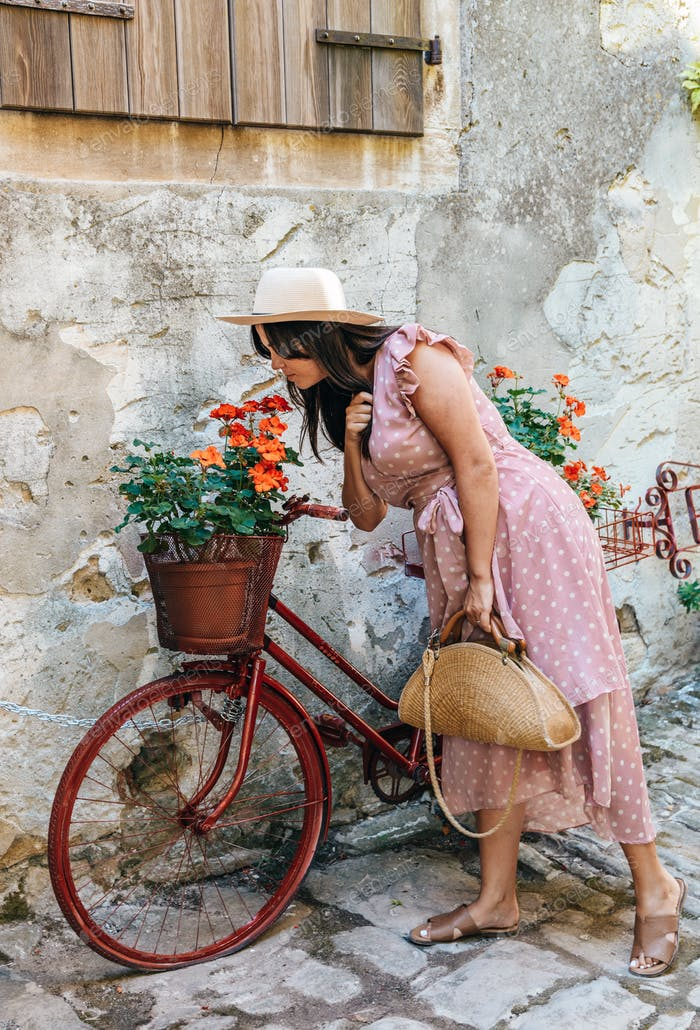 Young woman smelling flowers, vintage, bicycle, street, decoration, summer, style.