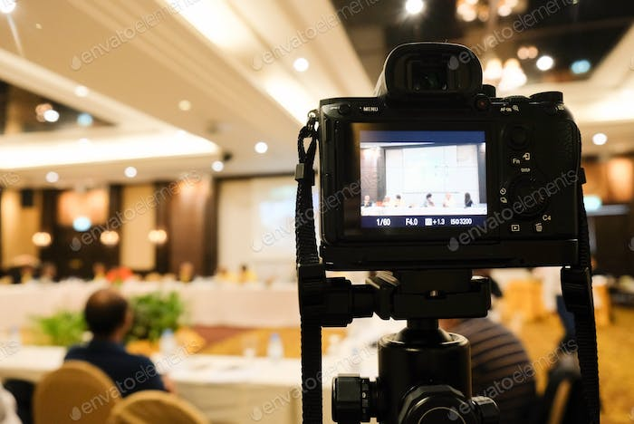 camera in business conference room recording participants and speaker technology transformation of