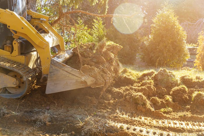 The bulldozer moves soil digging ground construction equipment