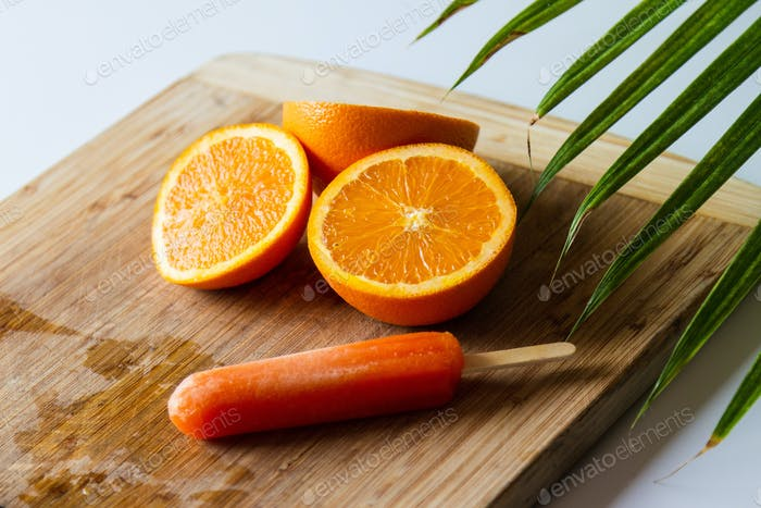 Oranges with orange popsicle. Summer and tropical  feeling