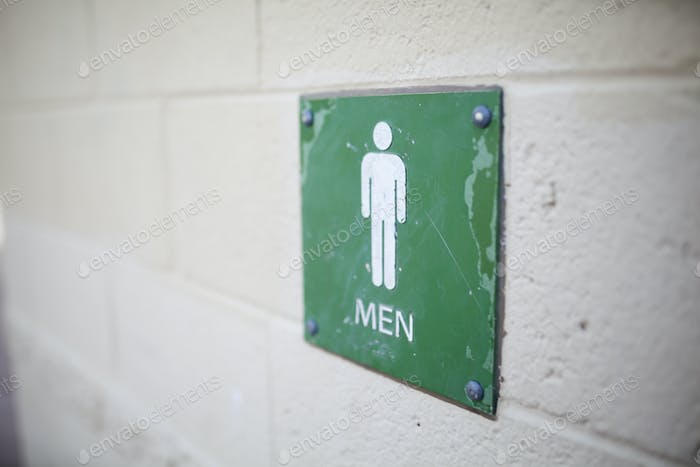 bathroom sign for mens bathroom in a public restroom