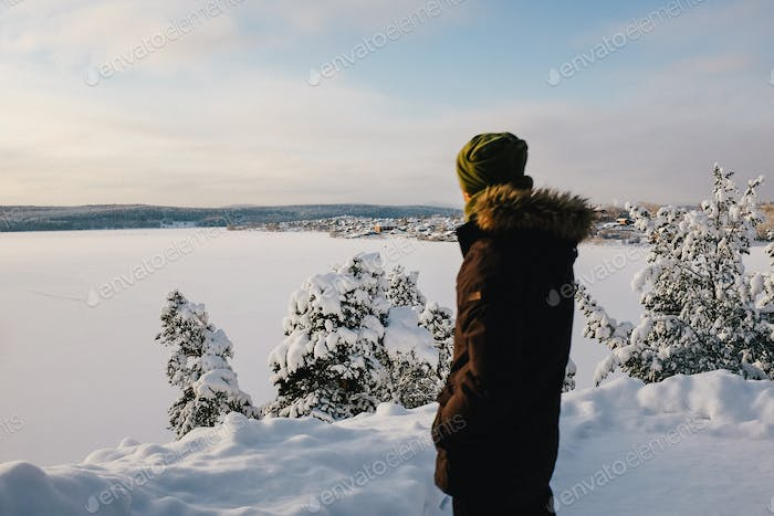 Young man looking winter pictures