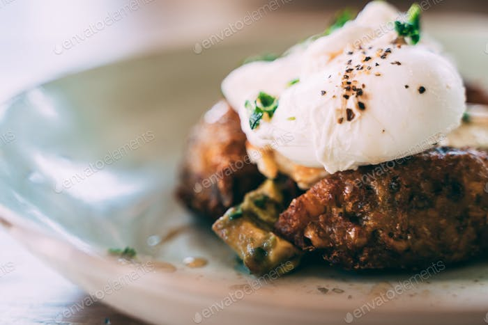 Sweetcorn fritter and poached eggs brunch