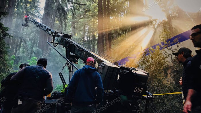 Camera crane shooting a movie in the forest