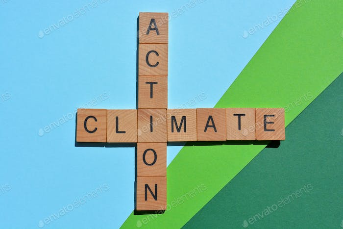 Climate Action, words in wood alphabet letters in crossword form isolated on green blue background