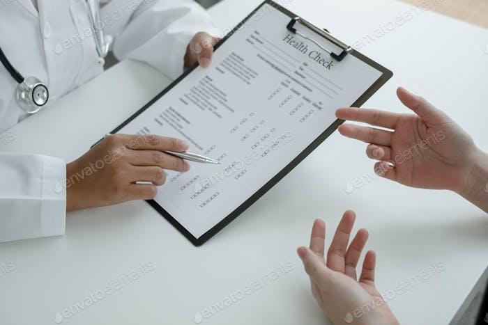Female doctors explain and recommend treatment after a Male patient meets a doctor and receives resu